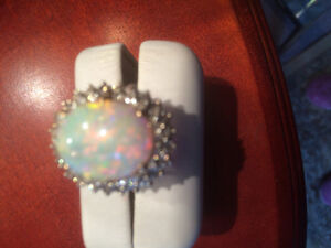 Massive Australian Opal encrusted with diamonds 18 k yellow gold
