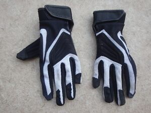 Nike kids small(5-10 yr old) football gloves. Used one season.