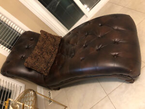 Brown leather tufted chaise lounge chair