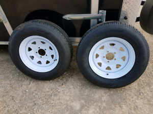 NewTrailer tires and rims for sale 350 or best offer