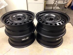 "SET OF FOUR NEW 17"" STEEL RIMS"