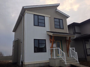 Modern Exterior Backing onto Green Space Ready Now!