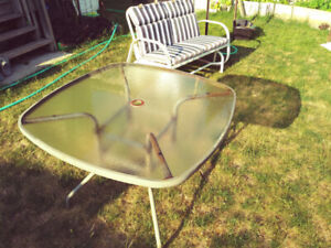 Patio glass table, swing chair with cushion