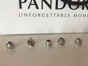 Pandora Charms in new condition
