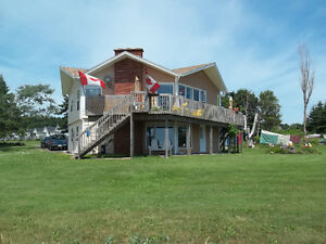 10 cottage business plus a 4 bedroom 2200sq ft Ocean Front Home