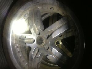 Old auto body parts and Pontiac G6 wheels