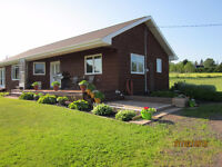 Bungalow with outbuildings on 5.35 acres in Hunter River
