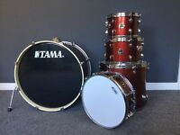 TAMA rhythm mate 5 piece drum kit with hi-hats, crash and ride cymbals. Red stream