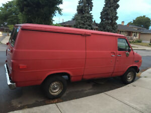 1990 GMC 20 full size working van as is needs some body work .
