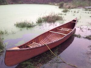 Classic 14 foot cedar strip with canvas cover canoe