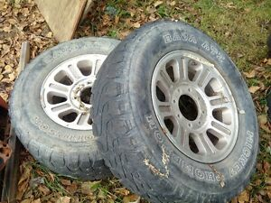 two aluminum rims from a 2007 f350