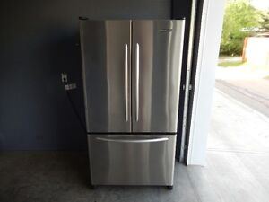 2006 Stainless fridge,water/ice feature $399 firm , can deliver.