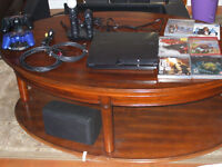 Complete Package PS3, with controllers, move, camera, and more!