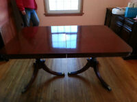Solid wood mahogany dining room table with chairs