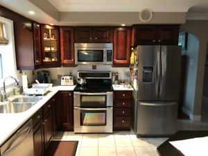 Kitchen cabinets and Corian counter top