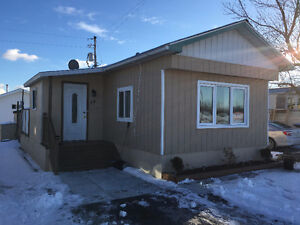 COMPLETELY RENOVATED INSIDE AND OUT - TRAILER HOME