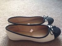 Women's white and black shoes