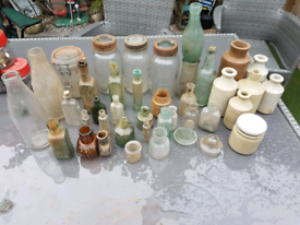 Loads and loads of antique glass bottles and pottery