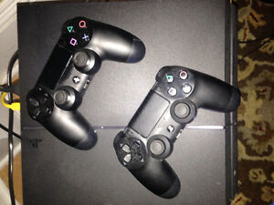 PS 4 with two remotes and 5 games