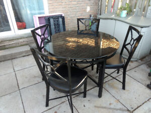 Round glass top with black metal trim & legs & 4 chairs