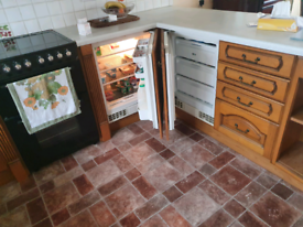 Kitchen units and intergrated fridge and freezer and worktops.