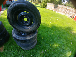 Selling 4 cooper life liner tires with steel rims