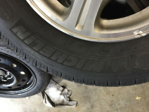 205/65/15 Michelin Tires Defender on Ford Taurus alloys