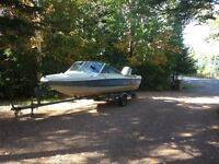 Blue & Cream Powerboat and Trailer and 50 HP Evinrude