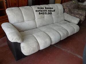 Attention, Voici 2 tres beau sofa-lit neuf recu a mon marcher au