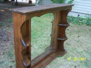 Wooden stand for sale with decorative mirror.