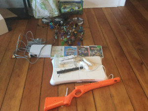 Wii console with Games and Skylanders Figures