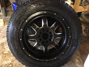 Awesome Ram winters,  275/60R20  Toyo Observe GSi-5 on RTX rims