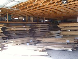 clearance on selected slabs and hardwood lumber