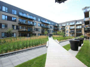 New Top Floor condo with indoor parking available in Dorval
