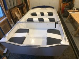 Two 14 ft fiberglass boats