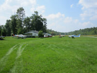 Aircraft, airplane friendly airfield cottage home on the lake