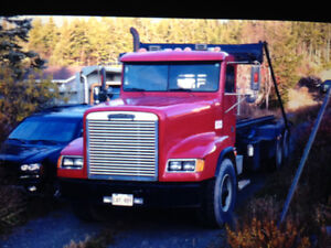 1996 freightliner rolloff truck and two bins