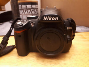 NIKON D3000 (BODY) + CHARGER + CARRYING CASE