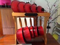 Red le creusset pan set and two chausseur casserole pots
