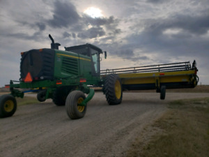 2012 John Deere A 400 swather (make a offer)