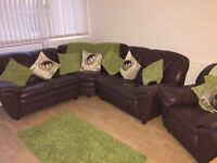 Brown leather corner settee and chair