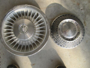 1 Ford -10 inch -  and 1 Unknown - 14 inch- hubcaps