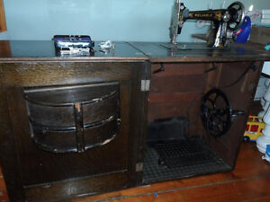 Antique Sewing Machine in Wood Cabinet