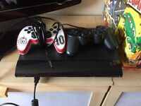 Playstation 3 with 7 amazing games and 2 controllers
