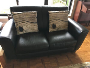 Natuzzi black leather loveseat