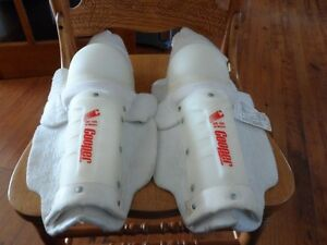 "2 pairs shin pads: Cooper 12"" white & Hispeler 13""  red black"