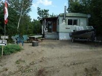 Seasonal Site with Mobile Home for Sale at Rickers Campground