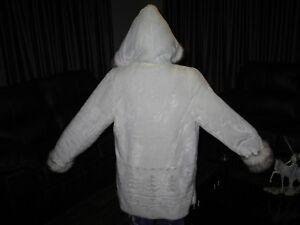 WOMAN COAT New never worn white 3/4 lenght with faux trim.