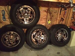 18 inch 8 bolt rims and tires for chev or gmc 2500 3500. $1,000