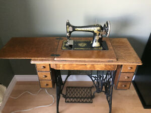 Antique Singer Sewing Machine.  Offers welcome